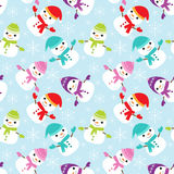 Pattern with cute snowmen. Vector seamless pattern with cute snowmen Stock Photography