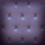 Pattern of dark violet leather seat upholstery Stock Photos