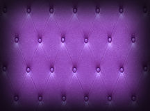 Pattern of dark violet leather seat upholstery Stock Photo