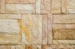 Pattern of decorative brown grey slate stone wall surface. Royalty Free Stock Photography