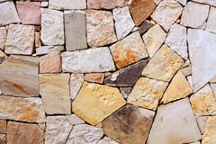 Pattern of decorative colorful stone wall background. Stone wall texture abstract wall.  royalty free stock image