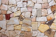 Pattern of decorative colorful stone wall background. Stone wall texture abstract wall.  royalty free stock photo