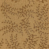 Pattern of the decorative leaves and twigs - leather texture. Seamless background Stock Photos