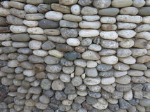 Pattern of decorative round stone wall surface Stock Image