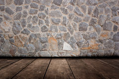 Pattern of decorative stone wall and wood flooring surface Royalty Free Stock Image