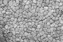 Pattern  decorative uneven cracked real stone wall surface Royalty Free Stock Photography