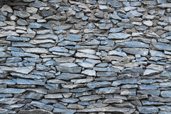 Pattern  decorative uneven cracked real stone wall surface Stock Photos
