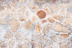 Pattern  decorative uneven cracked real stone wall surface with cement Stock Photo