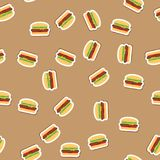 Pattern delicious burgers with juicy meat, vegetables and cheese on fresh bun with sesame on beige background. Burger. Pattern background Royalty Free Stock Photography