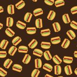 Pattern delicious burgers with juicy meat, vegetables and cheese on fresh bun with sesame on brown background. Burger. Pattern background Royalty Free Stock Photography