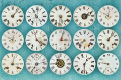 Pattern of different antique weathered clocks Stock Images