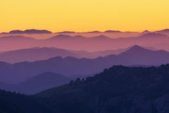 Pattern of distant mountain layers at sunset. Pattern of distant mountain layers at the sunset Royalty Free Stock Photography