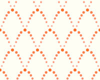 Pattern of dots, shades of orange. Abstract seamless pattern of dots, shades of orange on a white background Stock Photography