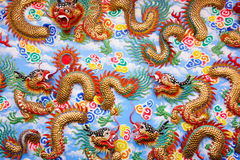 Pattern of dragon sculptures. On the wall of Naja Temple, public temple of Thailand stock photos