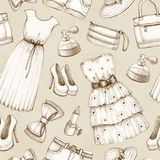 Pattern with a drawings of dresses and accessories Stock Photography
