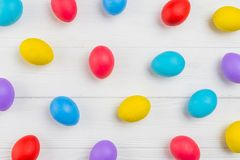 Pattern of Easter eggs scttered on grey woodentable stock image