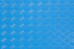 Pattern of embossed light blue metal. Surface from iron bunker door stock image