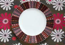 Pattern empty plate on the tablecloth. With flowers Royalty Free Stock Photography