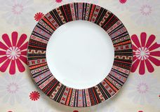 Pattern empty plate on the tablecloth. With flowers Royalty Free Stock Images