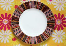 Pattern empty plate on the tablecloth. With flowers Royalty Free Stock Photo