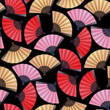 Pattern of fans. Vector seamless pattern with fans in red, pink and golden colors. Asian traditional design Stock Images