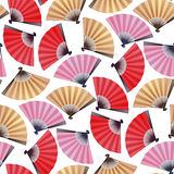 Pattern of fans. Vector seamless pattern with fans in red, pink and golden colors. Asian traditional design Royalty Free Stock Images