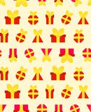 A pattern for festive paper from red gifts. A small gift box , red with a cute yellow ribbon, adorns itself with an advertising banner or website Royalty Free Stock Photos
