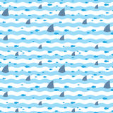 Pattern fins sharks and fish floating in blue sea. Sharks and fish swims in sea. Sharks pattern. Fish pattern. Pattern fins sharks and fish swimming in blue sea Stock Photos