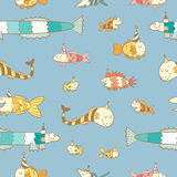 Pattern with fishes. Birthday seamless pattern with cute cartoon colorful fishes  in party hat  on  blue  background. Underwater life. Funny sea animals Royalty Free Stock Photos