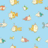 Pattern with fishes. Birthday seamless pattern with cute cartoon colorful fishes  in party hat  on  blue  baclkground. Underwater life. Funny sea animals Royalty Free Stock Image