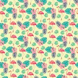 Pattern with flamingo and palm leaves, exotic birds and flowers Royalty Free Stock Photo