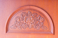 Pattern of flower carved on brown wood background Royalty Free Stock Photos