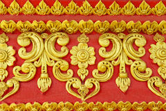 Pattern of flower carved on wall red background Stock Photos