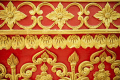 Pattern of flower carved on wall red background Royalty Free Stock Photography