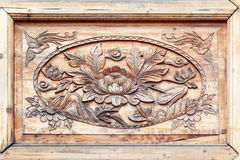 Pattern of flower carved on wood Stock Photos