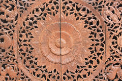Pattern of flower carved on wood background Stock Photography