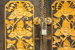 Pattern of flowers carved on wood door Stock Photo