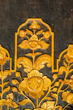 Pattern of flowers carved on wood door Stock Image