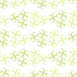 Pattern of flowers of green leaves or hearts on white background Stock Photo