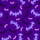 The seamless pattern of flying bats. The pattern of flying bats on the purple background. It can be tiled as the backdrop vector illustration