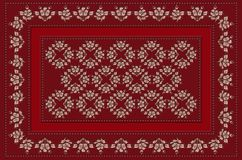 Frame of claret beads with red ribbon and pink  flowers with leaves  for embroidery on claret tablecloth Stock Photography