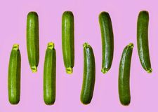 Pattern of fresh juicy courgettes on a contrast colour violet ba. Ckground. copy space Stock Image