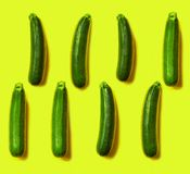 Pattern of fresh juicy courgettes on a yellow background. copy s. Pace Stock Photography