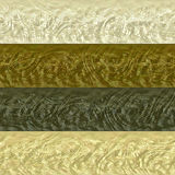 Pattern of gold, brown, white and gray stripes with embossed relief Royalty Free Stock Image