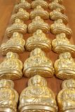 Pattern of gold buddha doll Royalty Free Stock Image