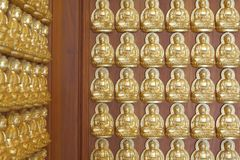 Pattern of gold buddha doll Stock Images
