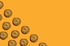 Pattern of gold medals on a yellow background.