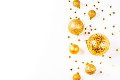 Christmas composition. a pattern of golden christmas balls and stars from above. Flat lay, top view. A pattern of golden christmas balls and stars from aboveFlat Royalty Free Stock Photos