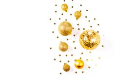 Christmas composition. a pattern of golden christmas balls and stars from above. Flat lay, top view. A pattern of golden christmas balls and stars from aboveFlat Stock Photography