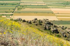 Pattern with grain fields and other crops, as seen from a hill. Autumn harvest period in south-east of Europe. Pattern with grain fields and other crops, as seen stock photography